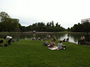 People relaxing at the Versailles gardens.